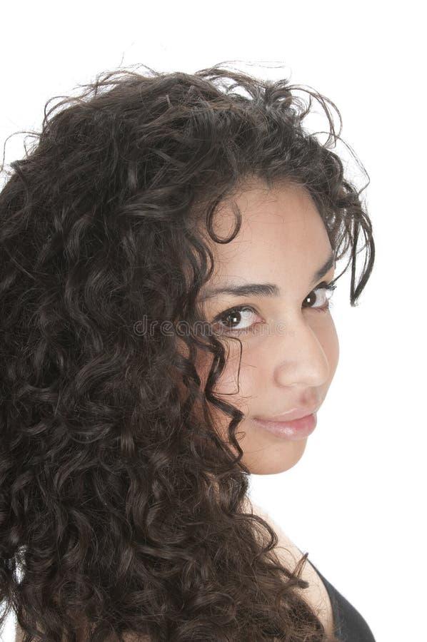Het leuke Spaanse meisje glimlachen stock foto
