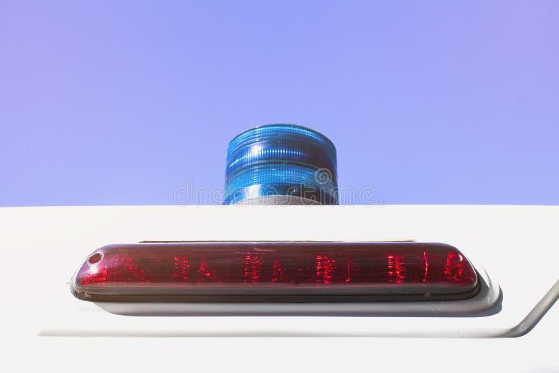 Het licht op de rug van een ziekenwagen stock foto
