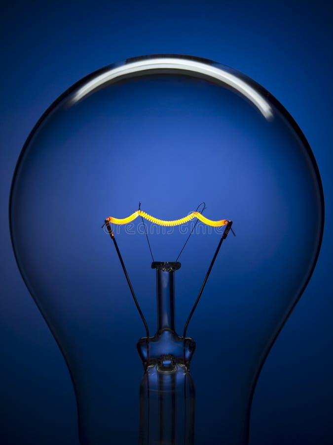 Het licht van de bol over blauw royalty-vrije stock fotografie