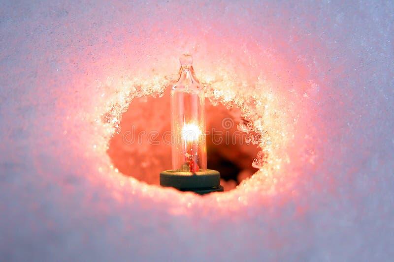 Het Licht van Kerstmis in Sneeuw royalty-vrije stock afbeeldingen