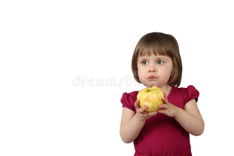 Het Littlrmeisje eet appel royalty-vrije stock afbeeldingen