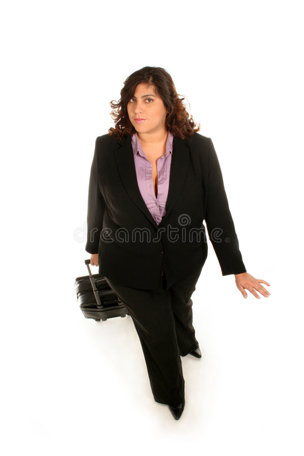 Het lopen aan haar bureau stock foto's