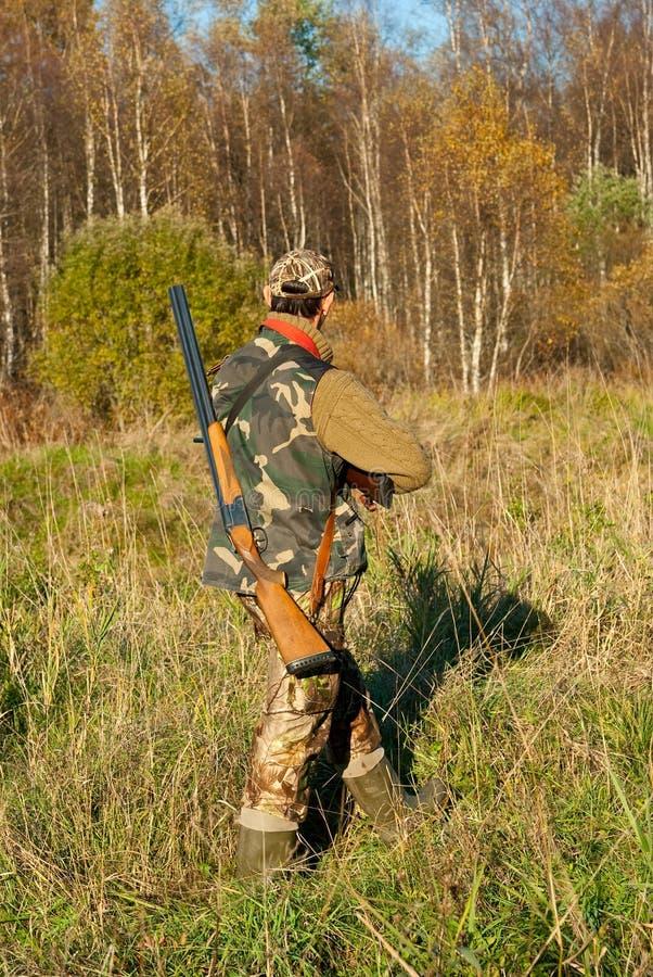 Het lopen van de jager stock afbeeldingen
