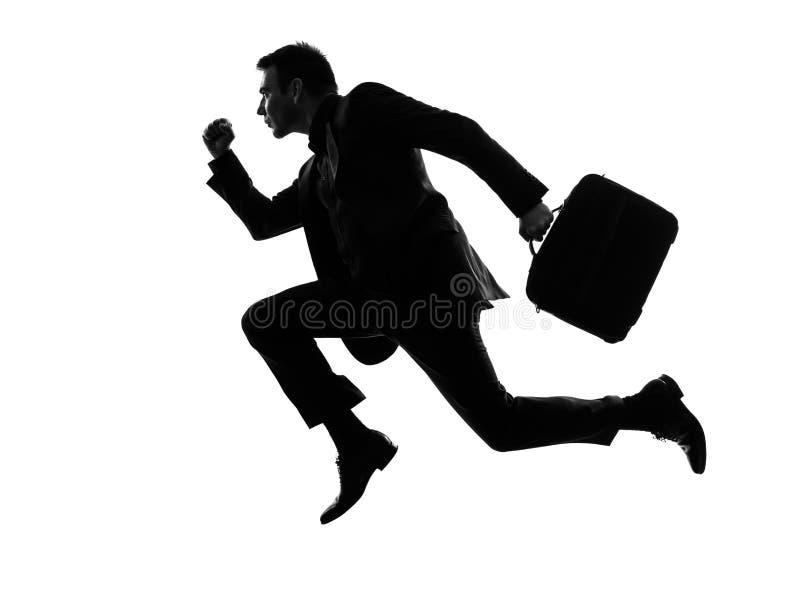 Het lopende silhouet van de bedrijfsmensenreiziger stock foto