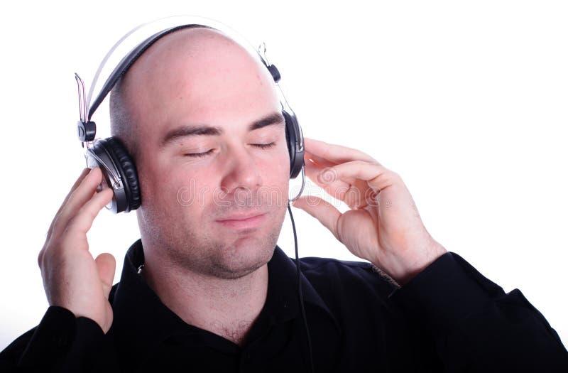 Het luisteren aan de muziek royalty-vrije stock afbeeldingen