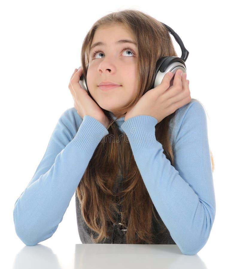 Het luisteren van het meisje muziek royalty-vrije stock fotografie