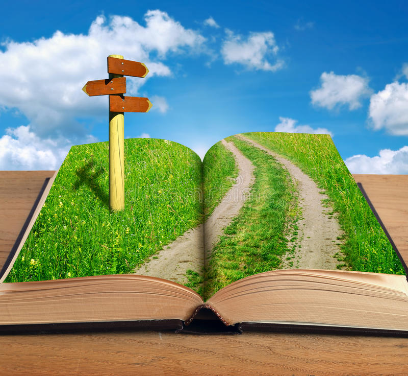 Het magische boek met wegbinnenkant en voorziet van wegwijzers stock fotografie