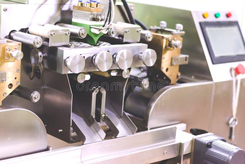 het maken van de oliemachine van Rijstzemelen stock foto