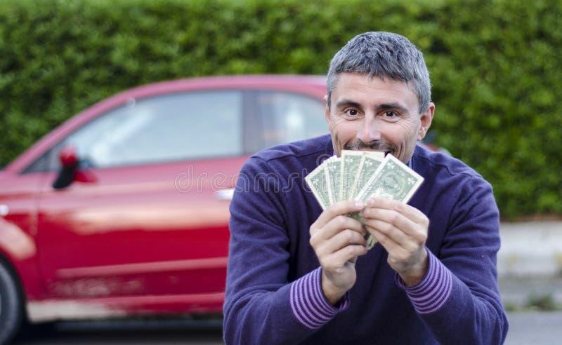 Het maken van de Verkopende Auto's van het Geld stock afbeeldingen