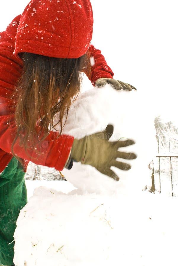 Het maken van een sneeuwman stock foto's