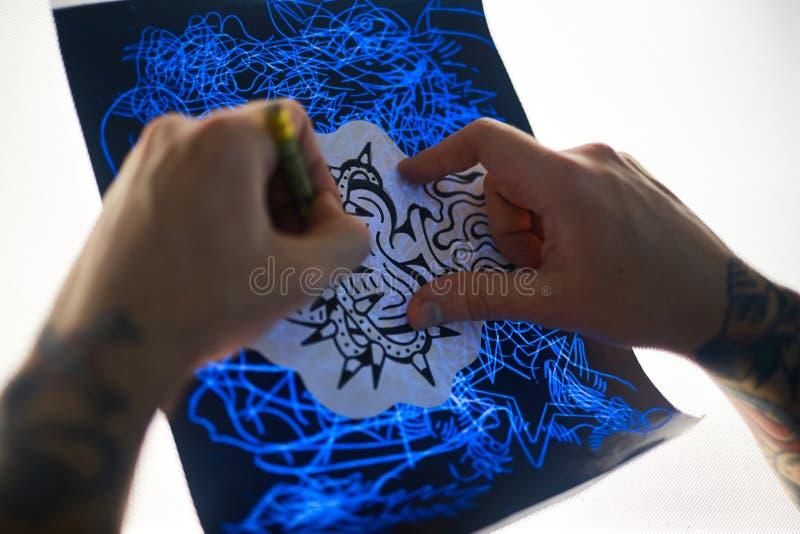 Het maken van tatoegeringsschets royalty-vrije stock afbeeldingen