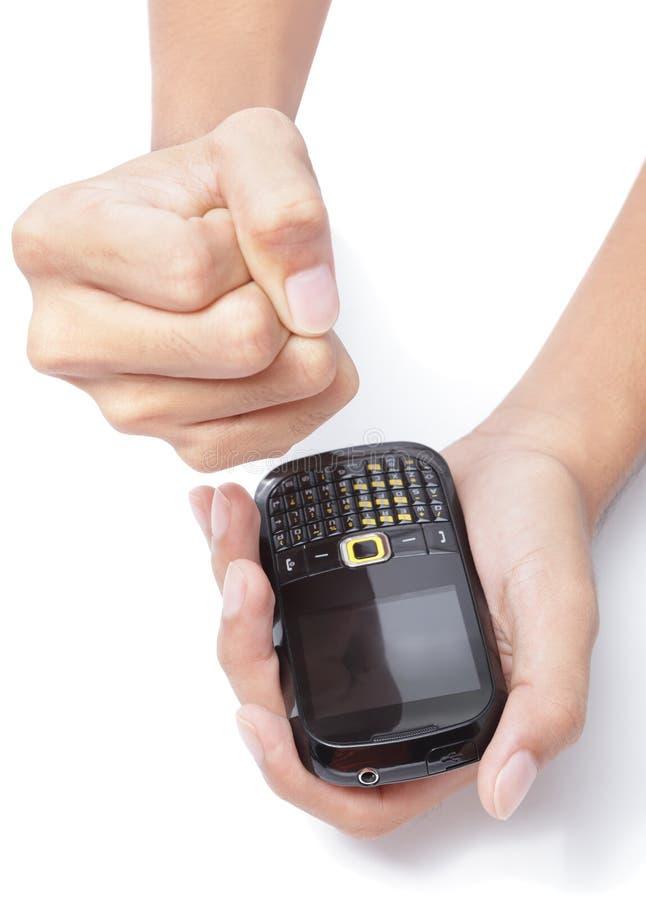 Het maken van vuist na ontvangst SMS stock afbeelding