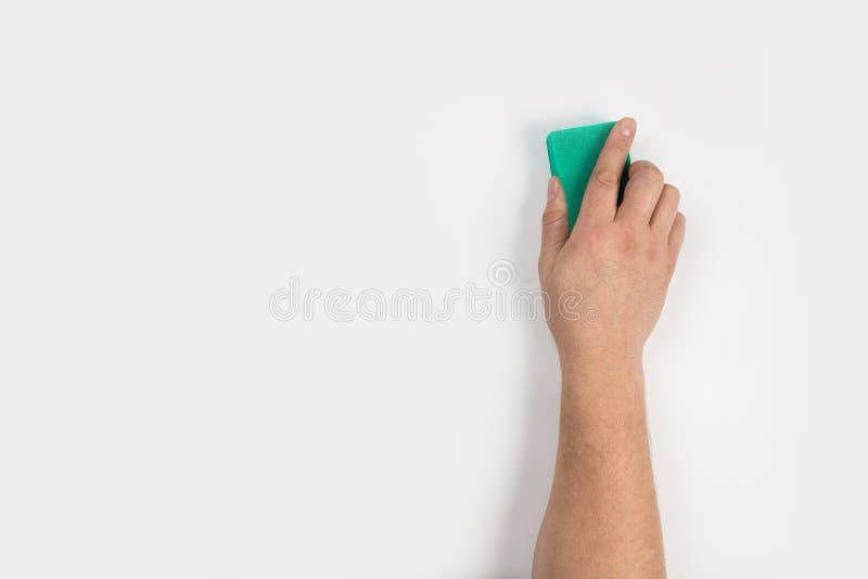 Het man hand schoonmaken op een witte achtergrond royalty-vrije stock foto's