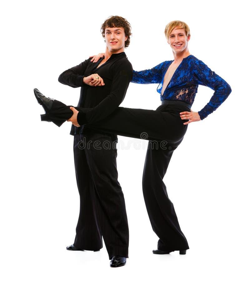 Het mannelijke been van de dansersholding van zijn grappige vriend royalty-vrije stock afbeelding