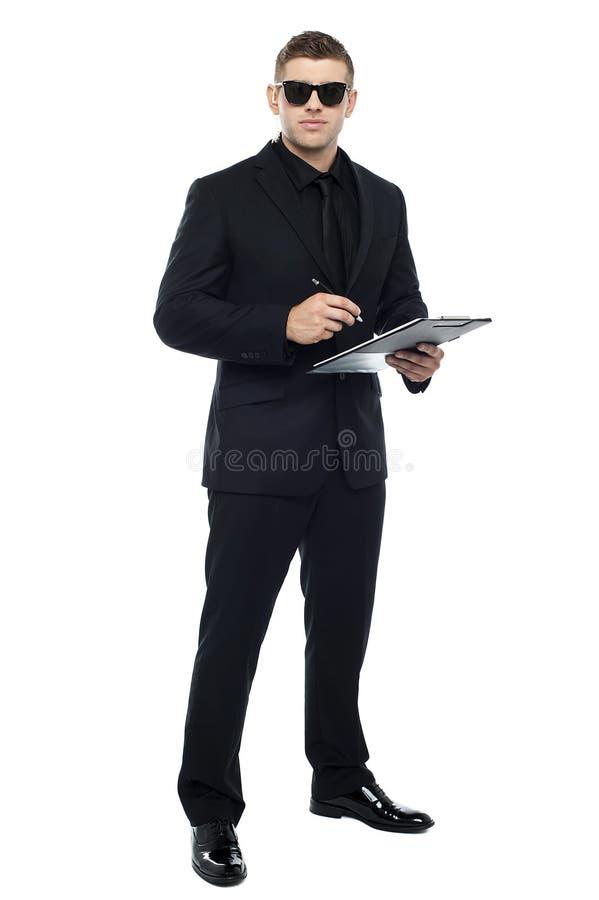 Het mannelijke klembord van de uitsmijterholding stock foto
