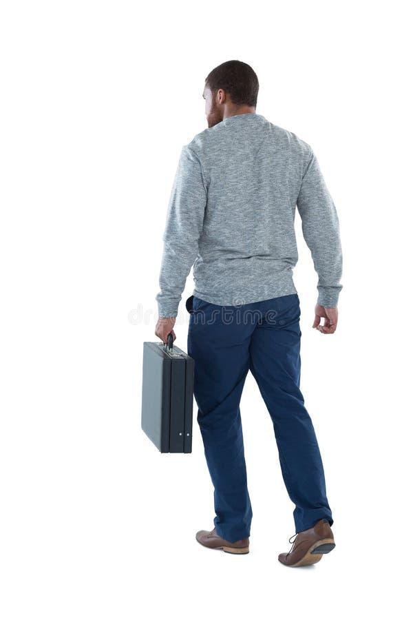 Het mannelijke uitvoerende lopen met aktentas royalty-vrije stock afbeelding