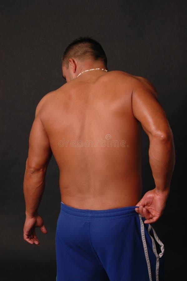 Het mannetje terug in blauw zweet royalty-vrije stock afbeeldingen