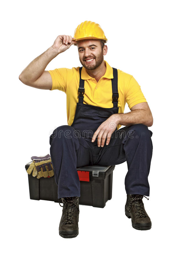 Het manusje van alles zit op zijn toolbox stock foto