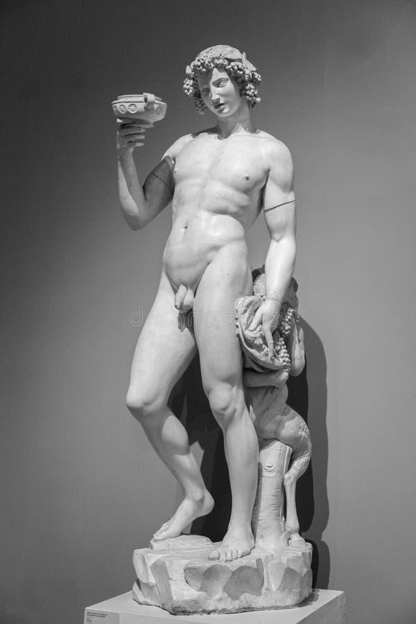 Het marmeren standbeeld van Bacchus Dionysus stock afbeelding