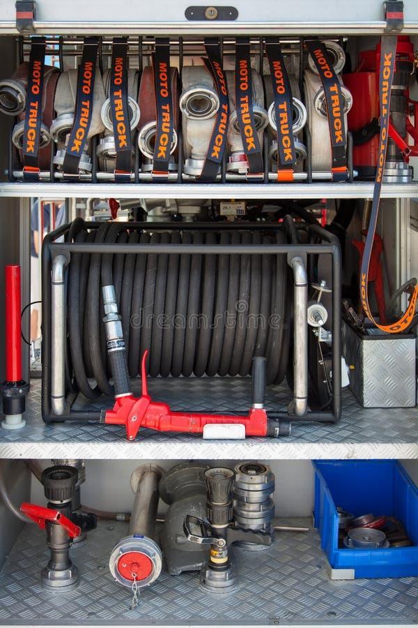 Het materiaal van de brandvrachtwagen stock foto