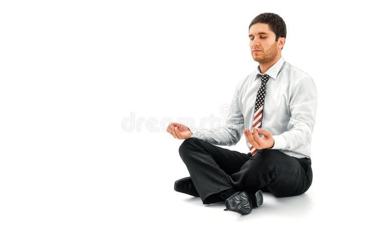 Het mediteren van de zakenman in lotusbloem stelt stock fotografie