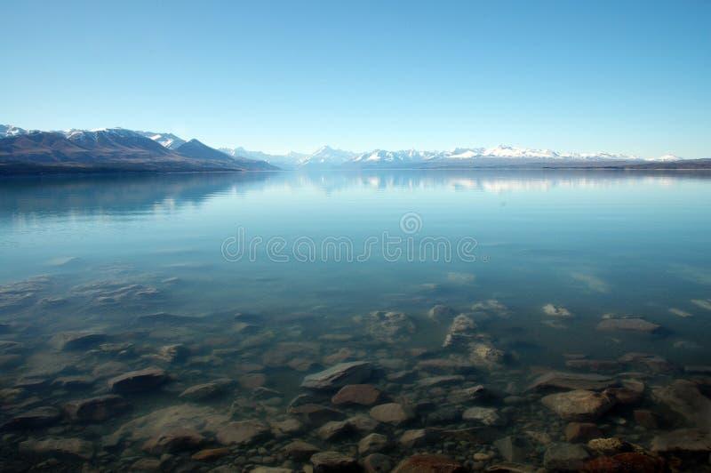 Het meer Pukaki & zet Cook op stock afbeeldingen