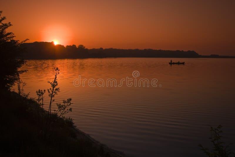 Het meer van de zonsopgang royalty-vrije stock foto