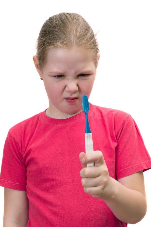 Het meisje borstelt tandentandenborstel royalty-vrije stock fotografie