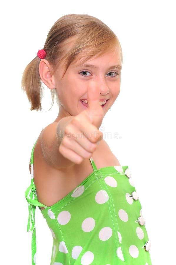Het meisje dat duimen toont ondertekent omhoog royalty-vrije stock fotografie