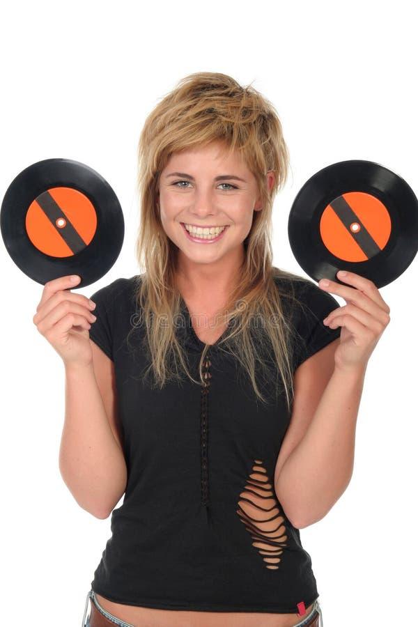 Het meisje dat een vinyl houdt registreert stock foto