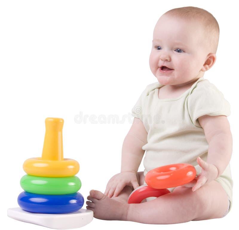Het meisje dat van de baby, het spelen glimlacht royalty-vrije stock afbeelding