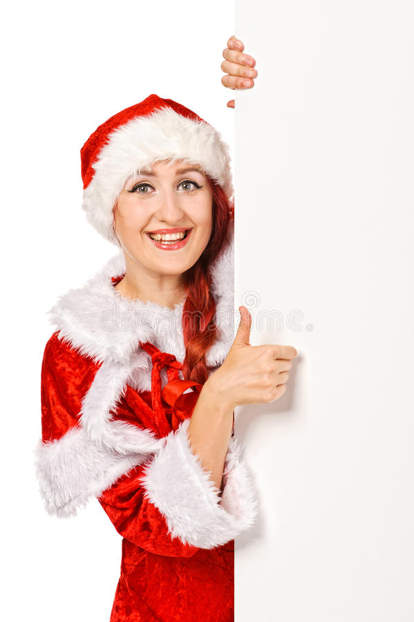 Het meisje dat van de kerstman van leeg aanplakbord gluurt royalty-vrije stock afbeelding