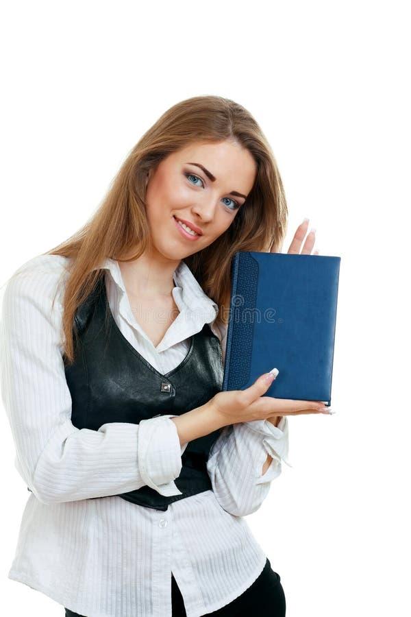Het meisje dat van de student een boek toont royalty-vrije stock fotografie