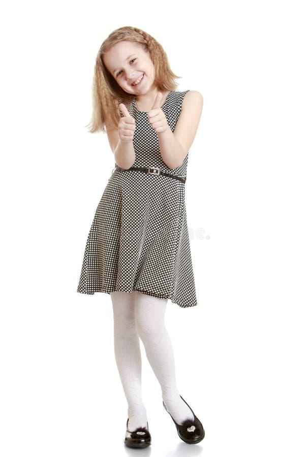Het meisje in de grijze kleding stock afbeeldingen