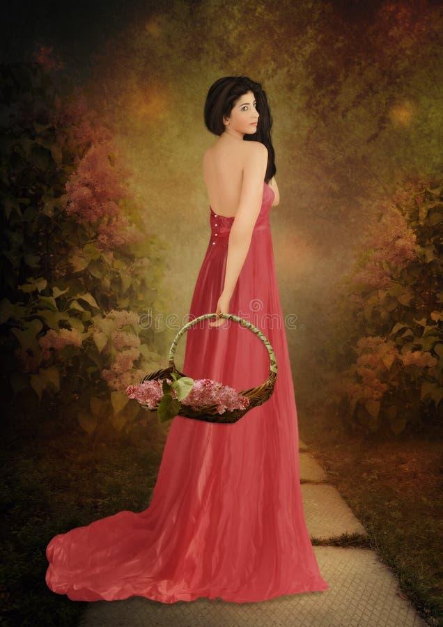 Het meisje in de tuin van seringen stock afbeelding