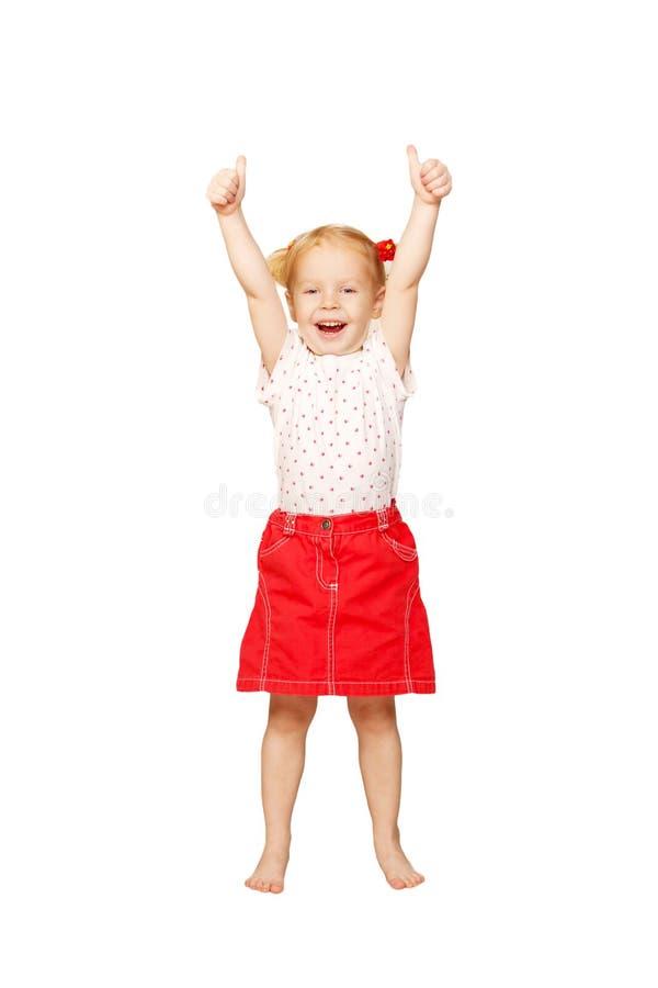Het meisje die van de baby duimen tonen ondertekent omhoog of o.k. royalty-vrije stock afbeeldingen