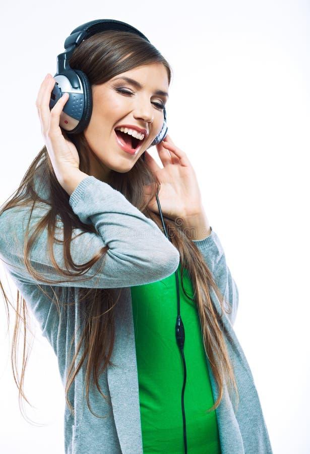 Het meisje die van de muziektiener tegen witte achtergrond dansen stock afbeelding