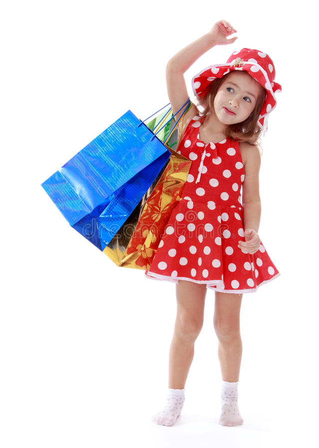 Het meisje in een de zomerkleding met stippen is royalty-vrije stock afbeeldingen