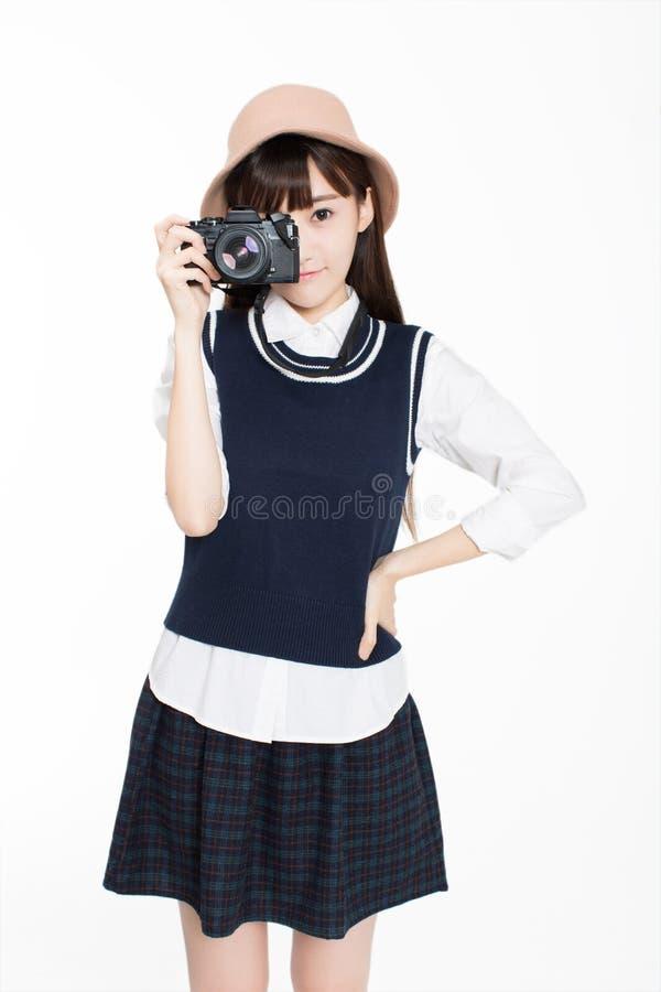 Het meisje is een fotografieenthousiast royalty-vrije stock fotografie