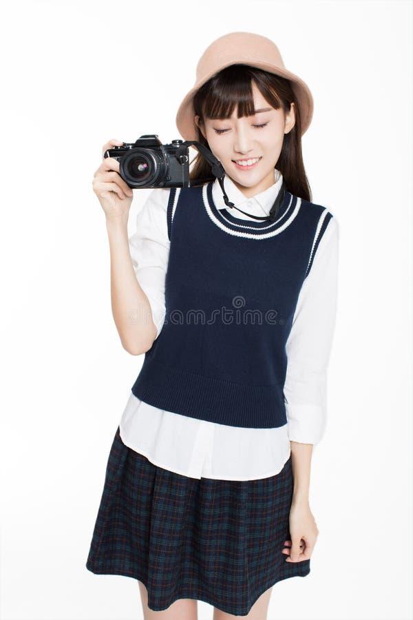 Het meisje is een fotografieenthousiast royalty-vrije stock foto's