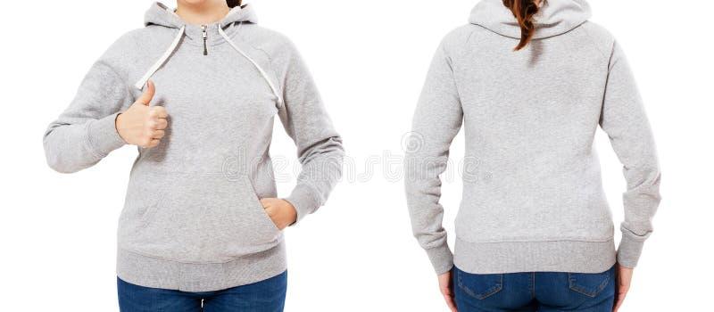 Het meisje in een grijze hoodie die als teken, kapspot tonen plaatste omhoog stock foto's