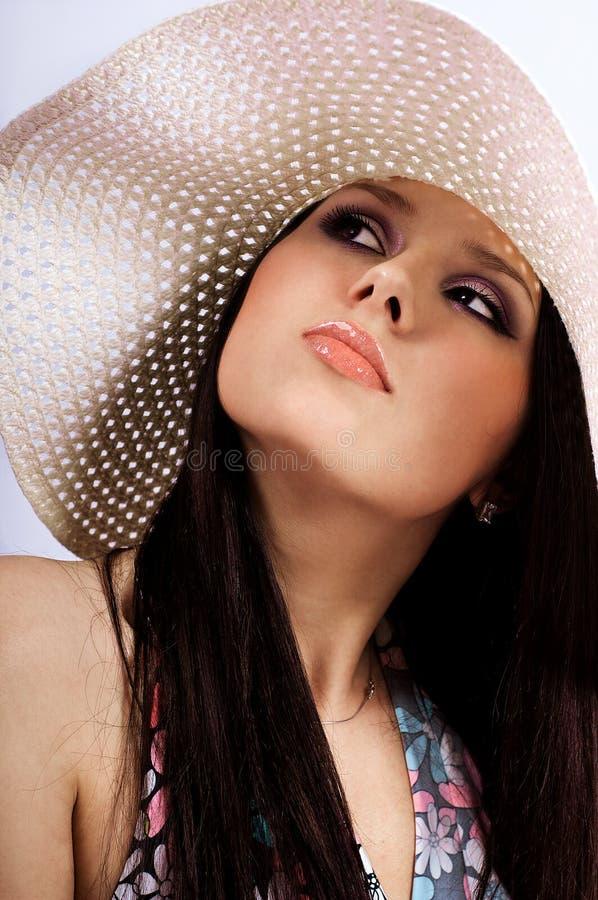 Het meisje in een hoed stock fotografie