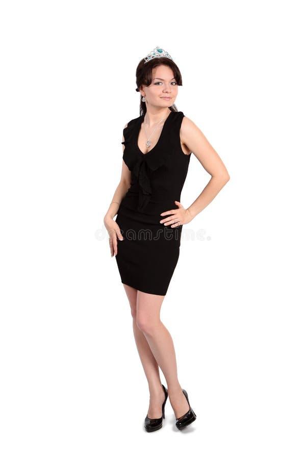 Het meisje in een kleine zwarte kleding stock afbeeldingen