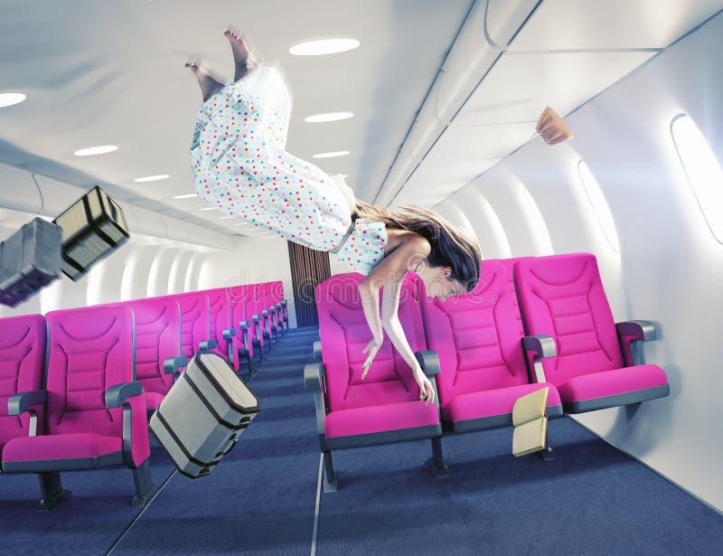 Het meisje in een vliegtuig stock afbeelding