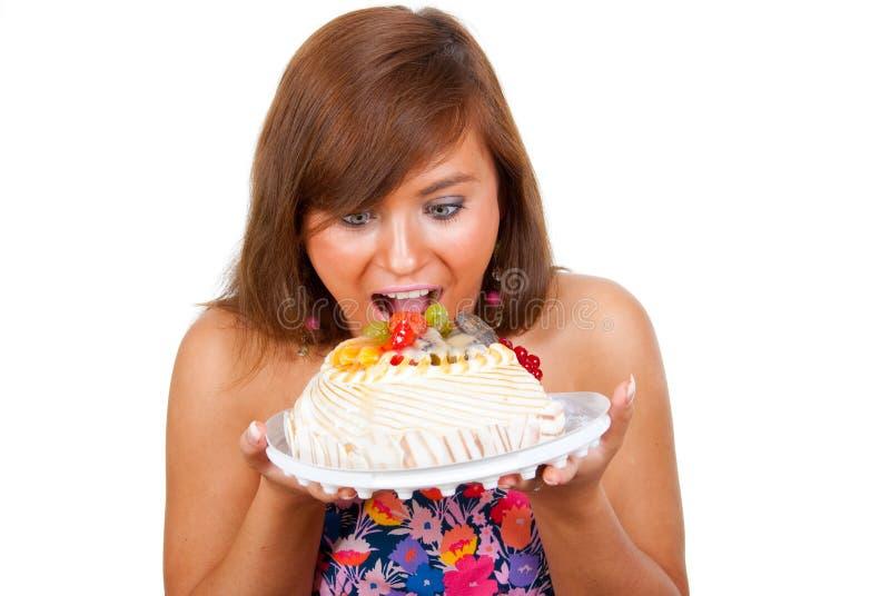 Het meisje eet cake royalty-vrije stock afbeelding