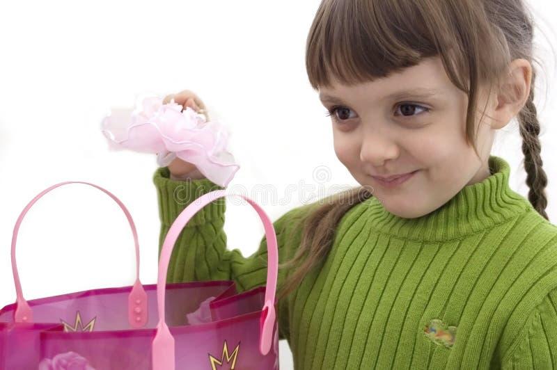Het meisje en de aankopen royalty-vrije stock afbeelding