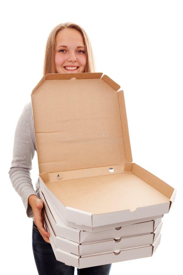 Het meisje en de dozen voor een pizza stock foto