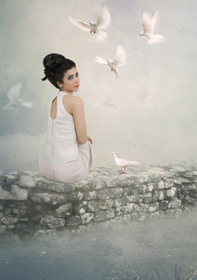 Het meisje en de duiven royalty-vrije stock afbeelding