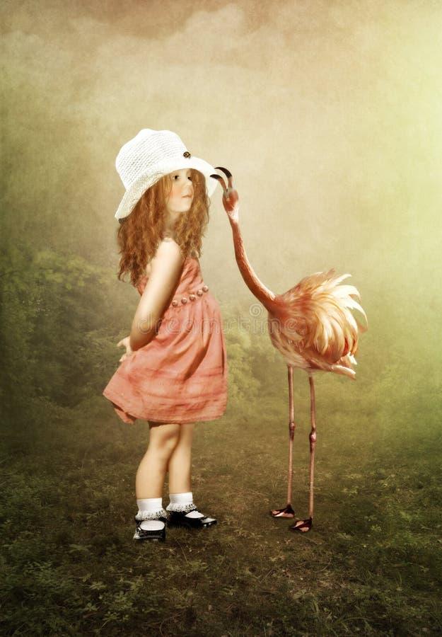 Het meisje en de flamingo's royalty-vrije illustratie