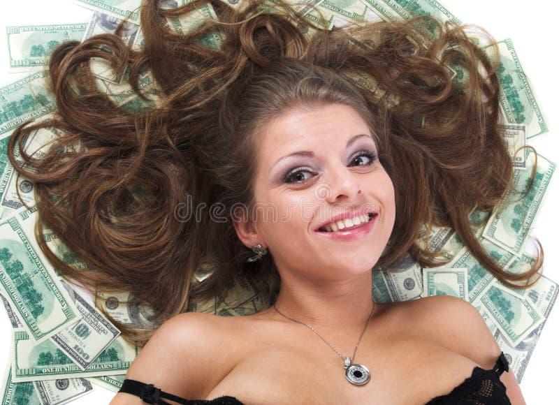 Het meisje en is heel wat geld stock foto